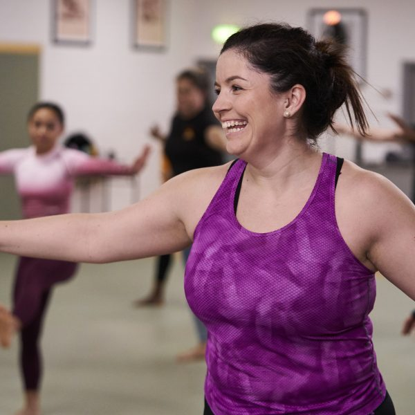 Smiley woman in aerobics class